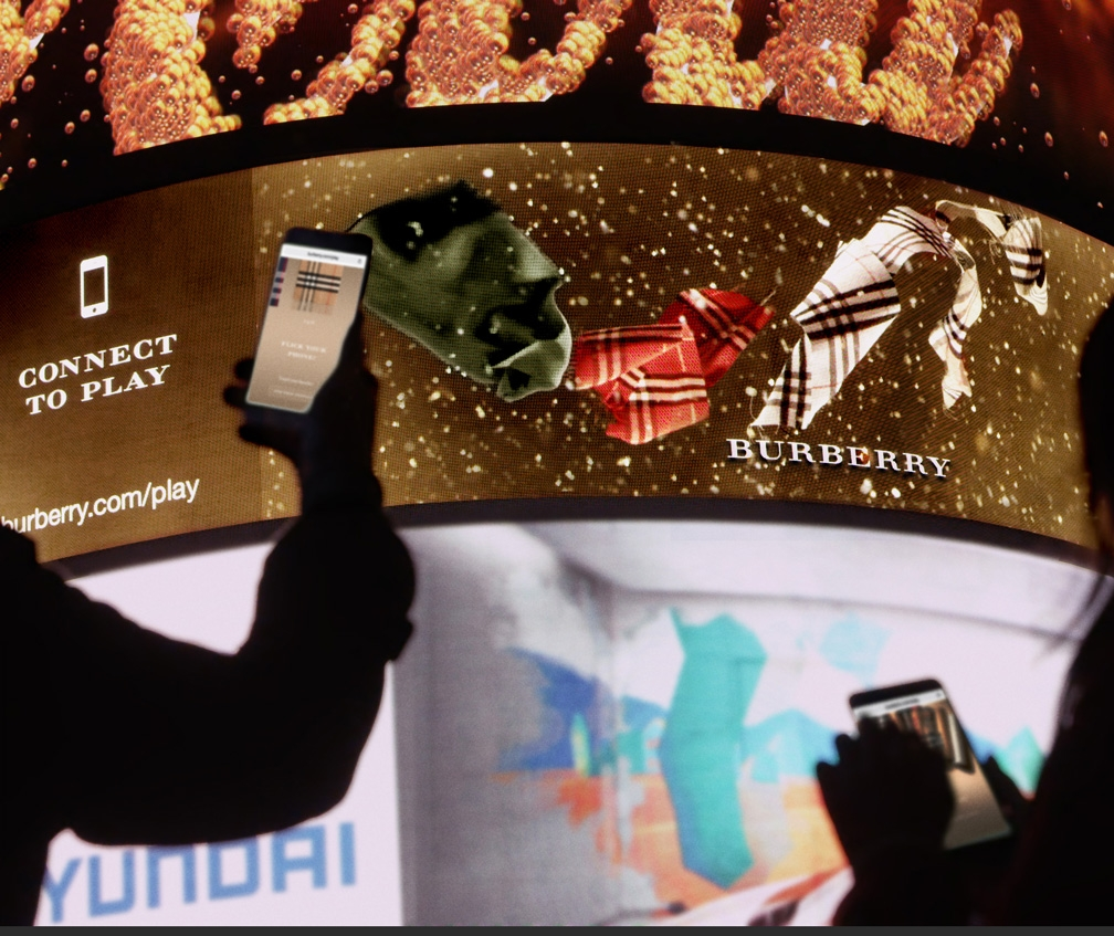 See what happens when Dreamworks' visualisation meets Burberry fashion in Piccadilly Circus