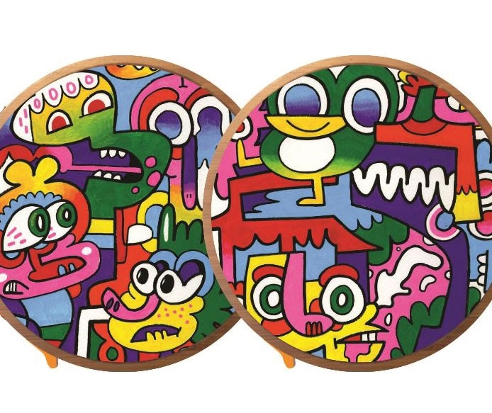 These drinks coasters have Jon Burgerman art on them - and can charge your phone