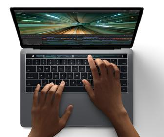 Apple's new MacBook Pro is faster, thinner and has a Touch Bar that you stroke to control apps